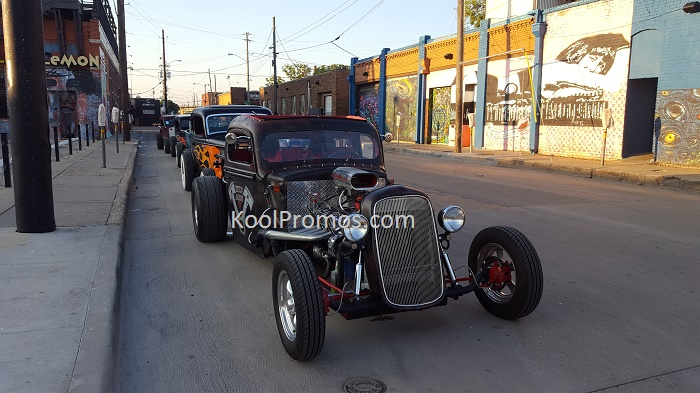 Hotrods along the street.