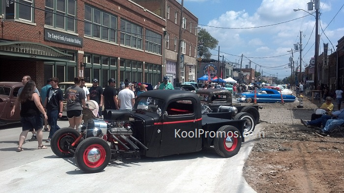 Vintage cars along street at car show